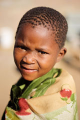 African boy in a Kalahari desert village